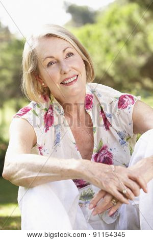 Portrait Of Senior Woman Relaxing In Countryside