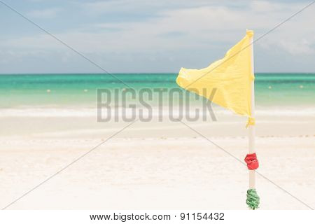 Warning yellow flag on the beach in Mexico.