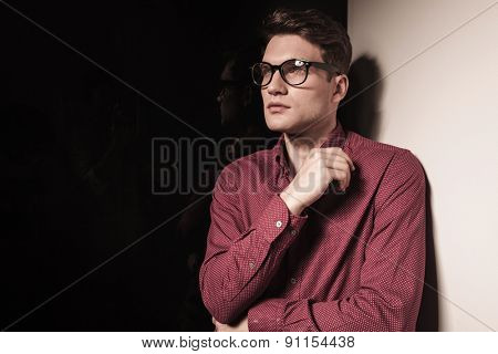 Side view of a handsome young business man looking away while thinking.