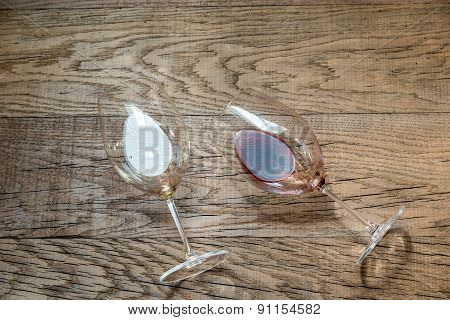 Glasses With Red And White Wine On The Wooden Background