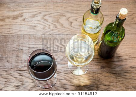 Glasses And Bottles With Red And White Wine
