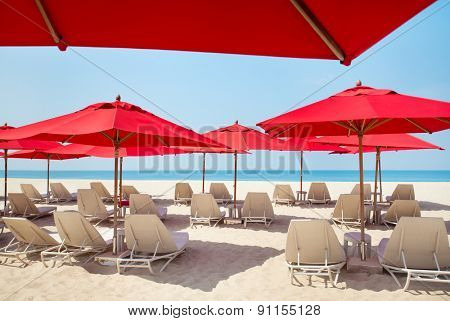 Beach chairs and umbrellas on a sand beach