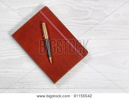 Executive Notepad With Pen On Rustic White Wood