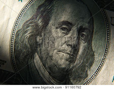 Benjamin Franklin's portrait is depicted on the $ 100 banknotes. Close up