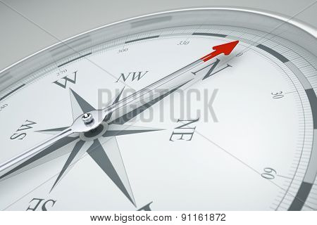 An image of a stylish compass with a red arrow