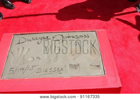 LOS ANGELES - MAY 19:  Dwayne Johnson hand and footprints at the Dwayne Johnson Hand and Foot Print Ceremony at the TCL Chinese Theater on May 19, 2015 in Los Angeles, CA