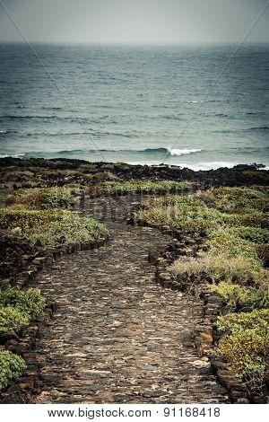 beautiful stone path to the sea horizone