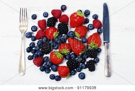 Fresh berries on old wooden background