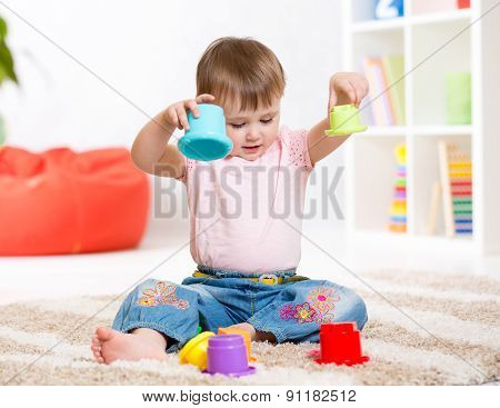 child playing with toys indoor