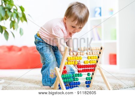 child girl playing with counter