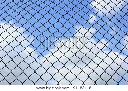 Wire Fence On Sky Background
