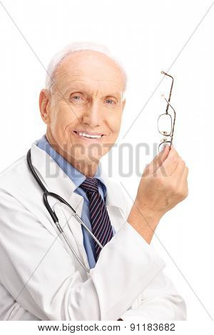 Studio shot of a mature doctor taking off his glasses, smiling and looking at the camera isolated on white background