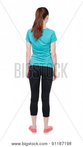 back view of standing young beautiful  woman. girl  watching. Rear view people collection.  backside view of person.  Isolated over white background.Sportswoman in black tights standing with her hands