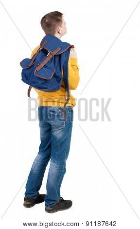 Back view of  young men with backpack. Rear view people collection. backside view of person.  Isolated over white background. guy in the yellow sweater standing sideways thrown behind a backpack.