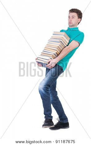 front view of going  handsome man carries a stack of books.  Rear view people collection.  backside view of person.  Isolated over white background. Thin student carries a heavy stack of books.