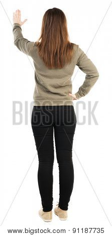 back view of young woman presses down on something. second hand she clicks on something. Rear view people collection. Isolated over white background.Sportswoman in black tights standing with her hands