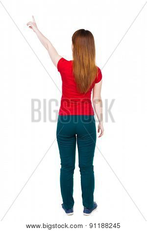 Back view of  pointing. Rear view people collection.  backside view of person.  Isolated over white background. The girl in green pants and shows his hand is his left hand up.