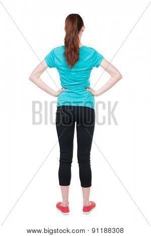 back view of standing young beautiful  woman. girl  watching. Rear view people collection.  backside view person.  Isolated over white background. Hands behind his back runner is placing hands on belt