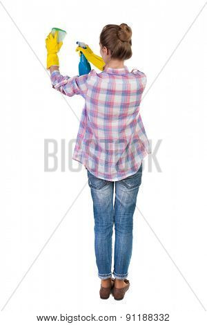 Back view of a housewife in gloves with sponge and detergent. girl  watching. Rear view people collection.  backside view of person.  Isolated over white background. The young girl engaged in cleaning