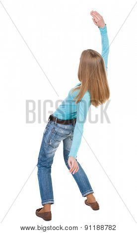 Balancing young woman.  or dodge falling woman. Rear view people collection.  backside view of person.  Isolated over white background. The girl in a blue sweater thrown back deviates hands