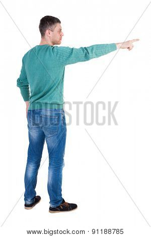 Back view of  pointing young men in jeans. Young guy  gesture. Rear view people collection.  Isolated over white background. The guy in the green jacket stands sideways and shows a finger right