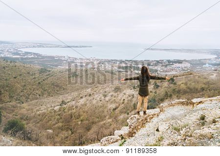 Happy Woman Standing Above The Bay
