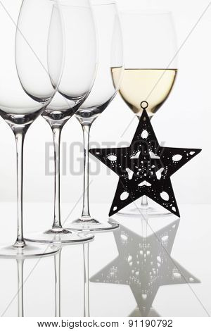 Four  Glasses  Of  Wine And Christmas Decoration