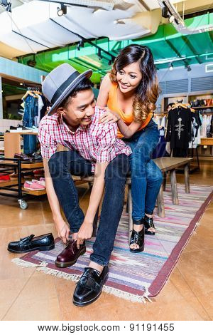 Asian couple buying shoes in store or shop