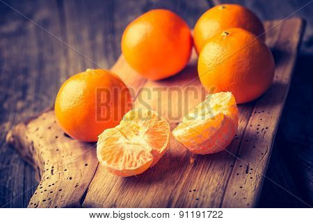 Vintage Photo Of Fresh Tangerines On Wooden Cutting Board