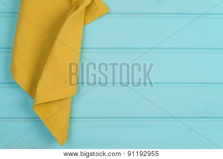 Green Towel Over Wooden Table