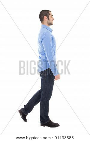 Side View Of Young Arabic Business Man In Blue Shirt Walking Isolated On White
