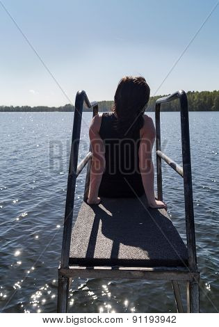 Young Woman Sitting Meditating And Enjoying The Views