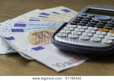 Concept Of Savings Analysis With Banknotes And A Calculator
