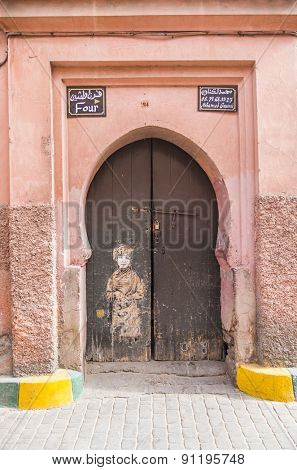 MARRAKESH, MOROCCO, APRIL 16, 2015: Old door in medina, near the Ben Youssef Madrasa