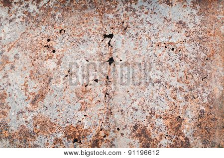 Old rusty sheet of metal with holes