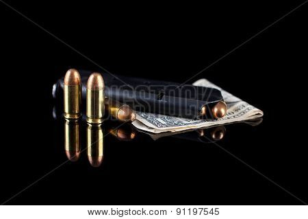 pistol magazine with ammunition and money