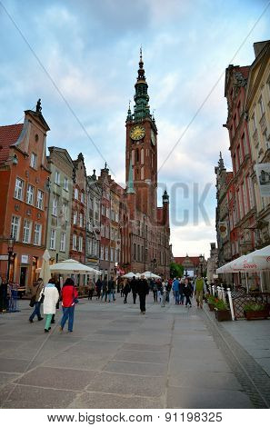 People walk Dluga street in Gdansk, Poland.