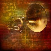foto of trumpet  - abstract grunge brown vintage sound background with trumpet - JPG
