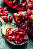 pic of pomegranate  - Pieces and grains of ripe pomegranate - JPG
