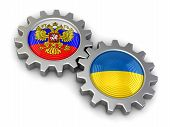 stock photo of snatch  - Ukrainian and Russian flags on a gears - JPG