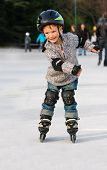 Smiling Boy In Roller Blades Outdoors