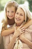 pic of grandmother  - Grandmother With Granddaughter Laughing Together On Sofa - JPG