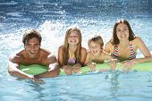 image of swimming pool family  - Family Relaxing In Swimming Pool Together - JPG