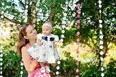 stock photo of mother baby nature  - Beautiful Mother And Baby playing in a park - JPG