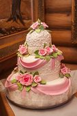 stock photo of three tier  - Wedding cake with luxury decorated in wedding party - JPG