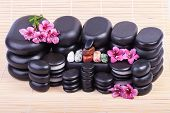 pic of chakra  - Set of smooth polished hot massage black stones with flowers and chakra crystals - JPG