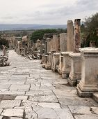 stock photo of street-art  - The street is a high point at Ephesus. It is paved and has many important structures along it. A great deal of art and marble are seen here. The Celsus library stood at the end of this street.