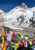 stock photo of buddhist  - view of Mount Everest with buddhist prayer flags from Kala Patthar way to Everest base camp Nepal - JPG