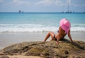 stock photo of beach hat  - Summer vacation woman on the beach in beach hat enjoying summer holidays looking at the ocean - JPG