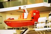 pic of life-boat  - Life boat attached to a cruise ship with a smooth watercolor filter - JPG